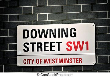 Downing Street sign in the City of Westminster in London England