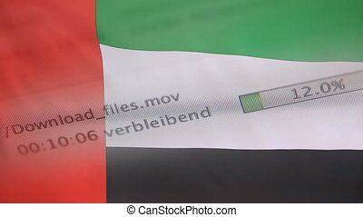 Downloading files on a computer, United Arab Emirates flag -...