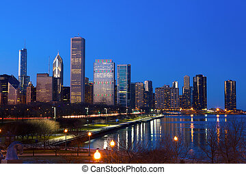 Downtown Chicago across Lake Michigan at dusk, IL, USA