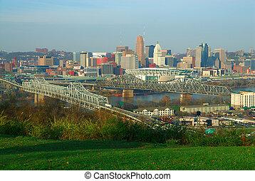 Downtown Cincinnati Ohio - Aerial view of downtown Cincinnati Ohio and the Ohio River from the hills of Devoe Park in Kentucky, USA. Brent Spence Bridge on the left, Railroad Bridge on the right, Paul Brown Stadium across the river.