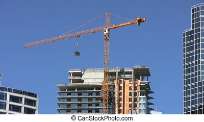 Downtown Construction Crane - A tall downtown construction...