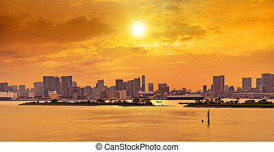 downtown district, Tokyo bay at sunset - waterfront...