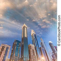 Downtown Dubai skyscrapers at night, skyward view