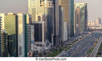 Downtown Dubai towers in the evening timelapse. Aerial view of Sheikh Zayed road with skyscrapers at sunset.