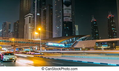 Downtown Dubai towers night timelapse. Vew of Sheikh Zayed road with skyscrapers.