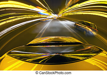 Downtown Highway - A car driving on a mortorway at high...