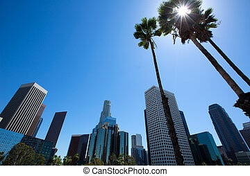 Downtown LA Los Angeles skyline California from 110 freeway with palm trees