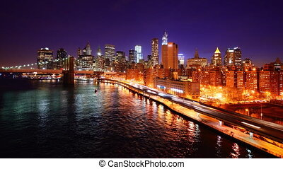 Downtown Manhattan time lapse viewed from above East River...