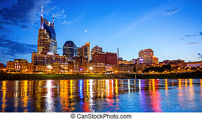 Downtown Nashville, Tennessee Cityscape Skyline Across The Cumberland River (logos blurred)