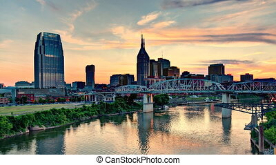 Time Lapse of downtown Nashville, Tennessee, USA from above the Cumberland River at dusk.