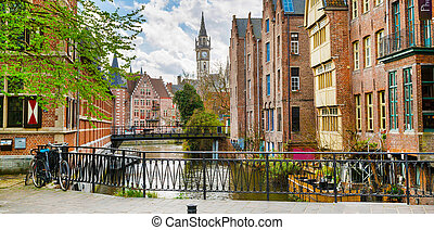 Downtown of Ghent with canal, clock tower, medieval houses, Belgium