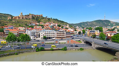 Houses, bridge, river and Narikala fortress on the hill in the downtown of Tbilisi. Georgia