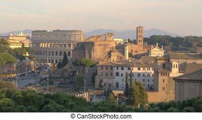 View of Basilica of Santa Maria in Ara Coeli and Colosseum, downtown Rome, Italy.