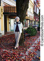 Downtown Shopping for Grandmother - Active senior rests...