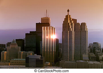 Sunrise reflected in the windows of office building in downton Toronto in Ontario in eastern Canada.