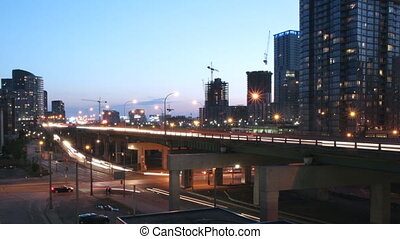 Timelapse of QEW highway, offramp and intersection. Dusk to night. Clip is assembled from hi-res stills taken with a Canon 550D camera.