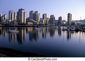 Skyscrapers of downtown viewed from across False Creek during sunrise- Vancouver (British Columbia), Canada.
