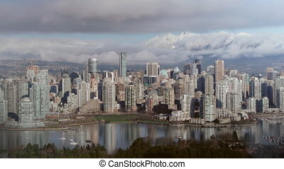 View of downtown Vancouver. Looking north with False Creek in foreground and mountains in the distance. Clip is assembled from hi-res stills taken with a Canon 550D camera.