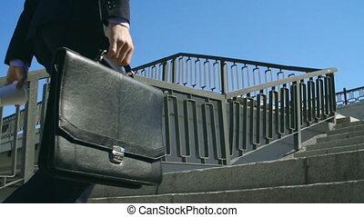 Downtown Walk - Camera following businessman walking in the...