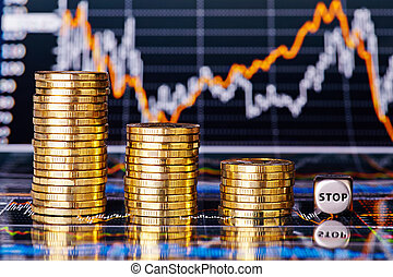 Downtrend financial chart, stacks of golden coins and dices...