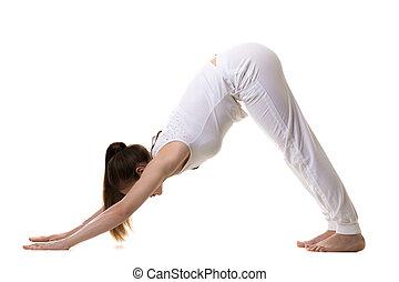 Downward facing dog yoga pose - Full length portrait of...
