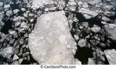 Downward movement of ice cracked, view from boat reflecting...
