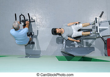 downward view of two men on exercise machines