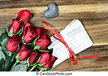 Dozen Roses with Old Letters - Long stem red roses with a...