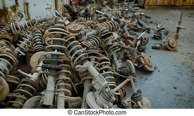 Dozens of old rusty metal scraps lying in piles on indusrtial scrapyard. Old car parts for recycling.