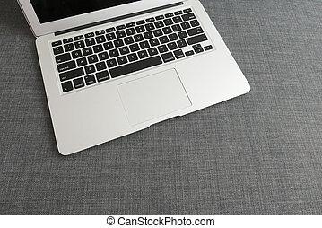 draagbare computer, op, de, blauwe , doek, achtergrond