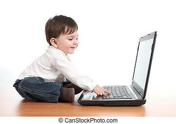draagbare computer, spelend, terwijl, computer, baby, het glimlachen, ongedwongen