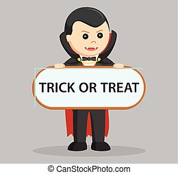 dracula.holding trick or treat sign