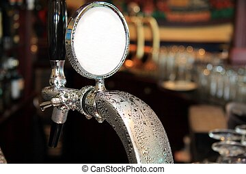 Draft Ale Tap - Draft beer tap covered in condensation water...