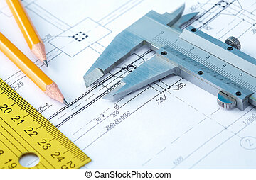 Close-up of draft with pencils and rulers