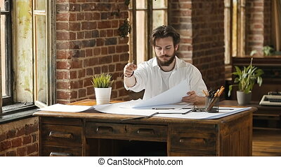 Drafting Office Work - Stylish hipster designer man dressed...