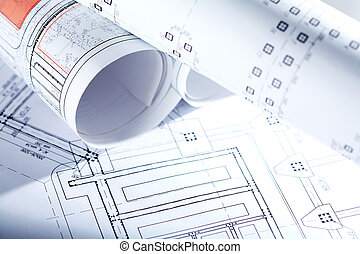 Close-up of blueprints with sketches of projects