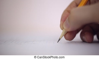 Draftsman draws a pencil on a sheet of paper