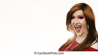 Portrait of a drag artist laughing against white background