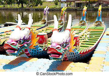 Dragon Boat - Chinese dragon boat stopped at the terminal is...