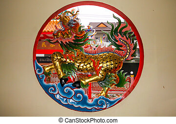 Dragon in round window in Chinese temple, Nan, Thailand