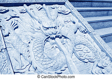 dragon king stone sculpture in a temple