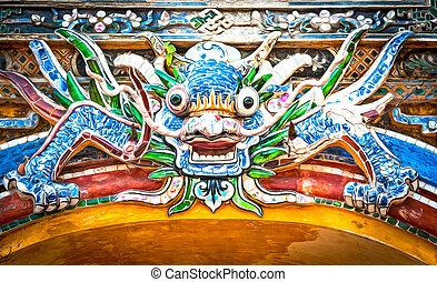 Dragon over gate to Hue citadel. Vietnam, Asia.