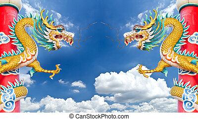 dragon statue against blue sky