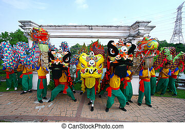 MALACCA - FEBRUARY 16: Lion dance troupe performs during Chinese New Year celebrations in Malacca. February 16, 2010 in Malacca, Malaysia.