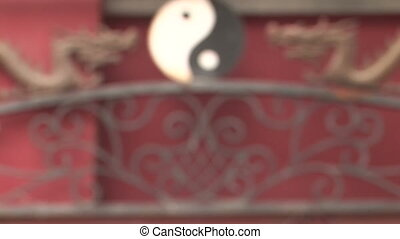 Dragons and Yin Yang Symbol coming into focus - Chinese yin...