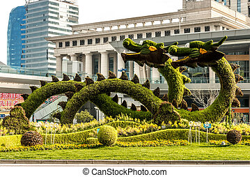 dragons sculptured trees in pudong shanghai china -...