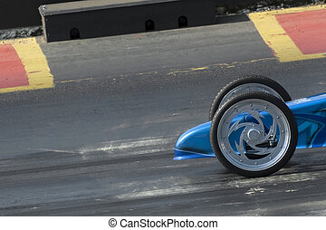 dragster wheels - dragster at the start of the quarter mile...