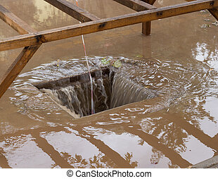 Drain with heavy rain draining away