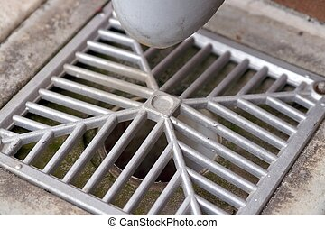close up of an angular water drain in an industrial building