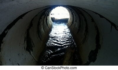 Drainage pipe under the highway - Shooting a functioning...